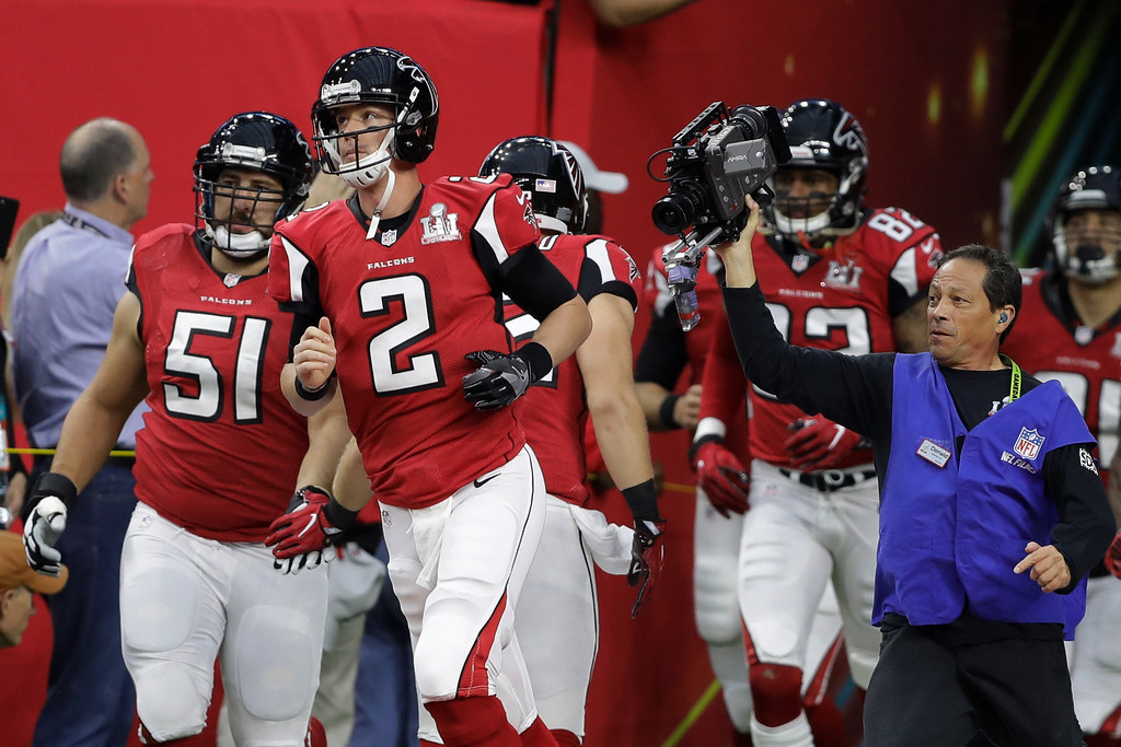 . Atlanta Falcons\' Matt Ryan leads the team onto the field, before the NFL Super Bowl 51 football game against the New England Patriots, Sunday, Feb. 5, 2017, in Houston. (AP Photo/Darron Cummings)