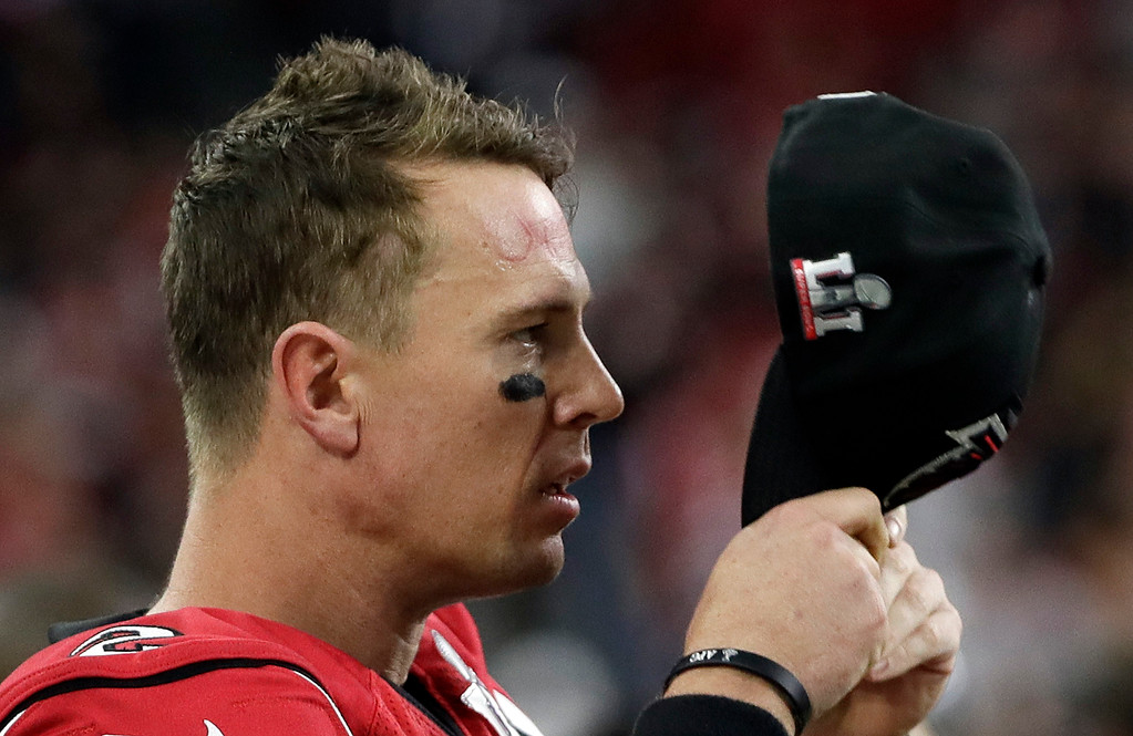 . Atlanta Falcons\' Matt Ryan puts a cap on the sideline during the first half of the NFL Super Bowl 51 football game against the New England Patriots Sunday, Feb. 5, 2017, in Houston. (AP Photo/Mark Humphrey)