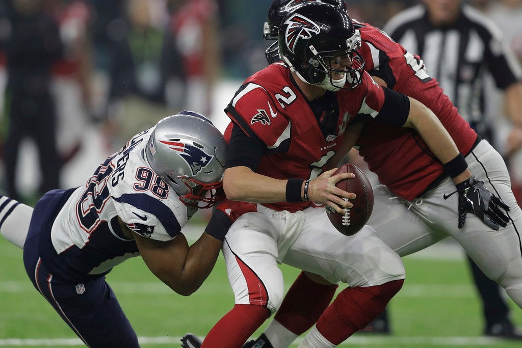 . New England Patriots\' Trey Flowers sacks Atlanta Falcons\' Matt Ryan, during the second half of the NFL Super Bowl 51 football game Sunday, Feb. 5, 2017, in Houston. (AP Photo/Darron Cummings)