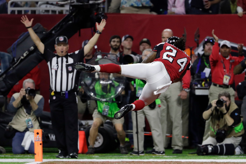 . Atlanta Falcons\' Devonta Freeman dives in the end zone after scoring a touchdown during the first half of the NFL Super Bowl 51 football game against the New England Patriots Sunday, Feb. 5, 2017, in Houston. (AP Photo/Matt Slocum)