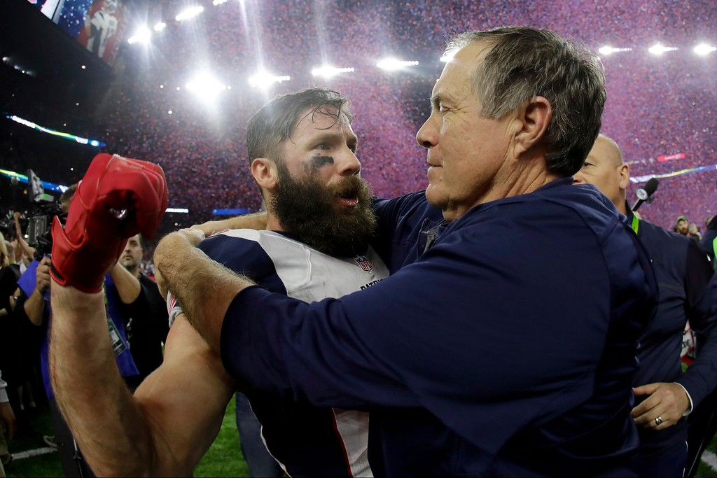 . New England Patriots head coach Bill Belichick congratulates Julian Edelman after defeating the Atlanta Falcons in overtime at the NFL Super Bowl 51 football game Sunday, Feb. 5, 2017, in Houston. The Patriots defeated the Falcons 34-28. (AP Photo/Matt Slocum)