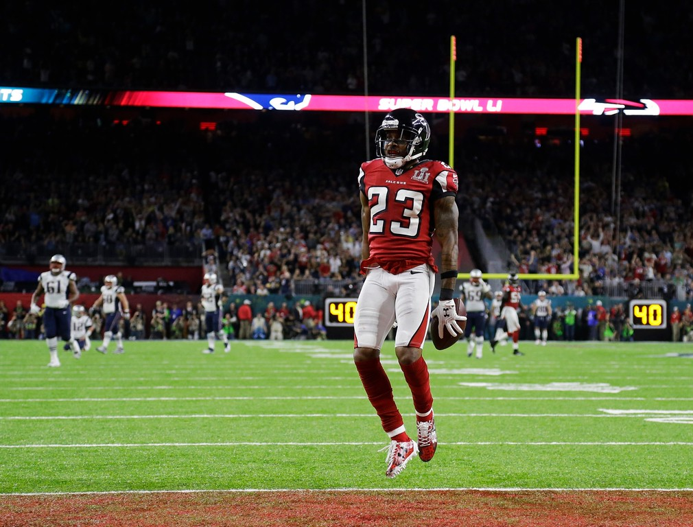 . Atlanta Falcons\' Robert Alford celebrates after scoring a touchdown during the first half of the NFL Super Bowl 51 football game against the New England Patriots, Sunday, Feb. 5, 2017, in Houston. (AP Photo/Elise Amendola)
