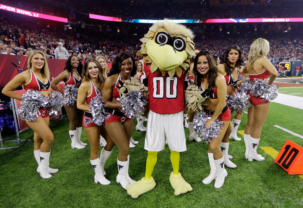 . The Atlanta Falcons mascot stands on the sideline with cheerleaders during the second half of the NFL Super Bowl 51 football game against the New England Patriots, Sunday, Feb. 5, 2017, in Houston. (AP Photo/Mark Humphrey)