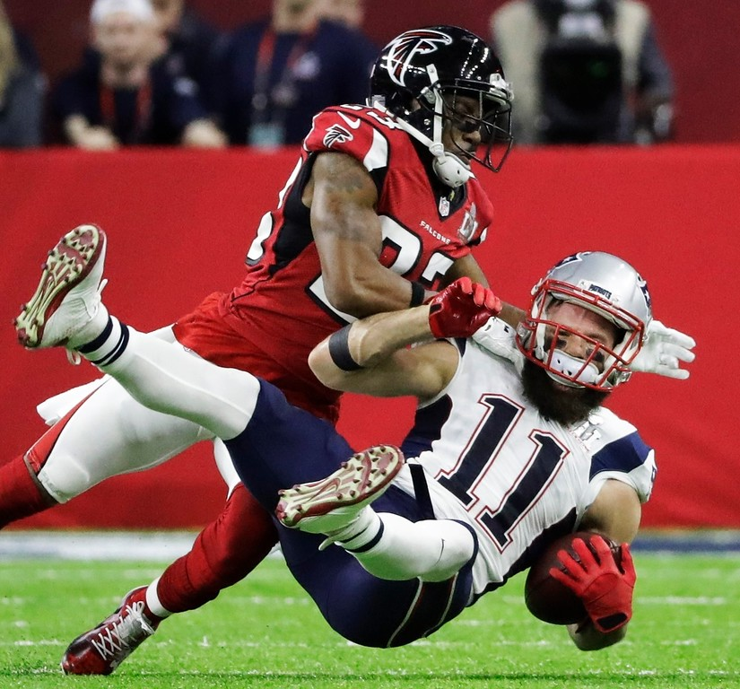 . New England Patriots\' Julian Edelman is tackled by Atlanta Falcons\' Robert Alford during the first half of the NFL Super Bowl 51 football game Sunday, Feb. 5, 2017, in Houston. (AP Photo/Elise Amendola)