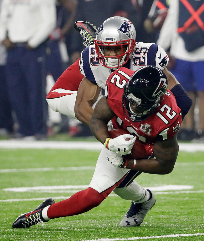 . New England Patriots\' Eric Rowe tackles Atlanta Falcons\' Mohamed Sanu during the second half of the NFL Super Bowl 51 football game Sunday, Feb. 5, 2017, in Houston. (AP Photo/David J. Phillip)