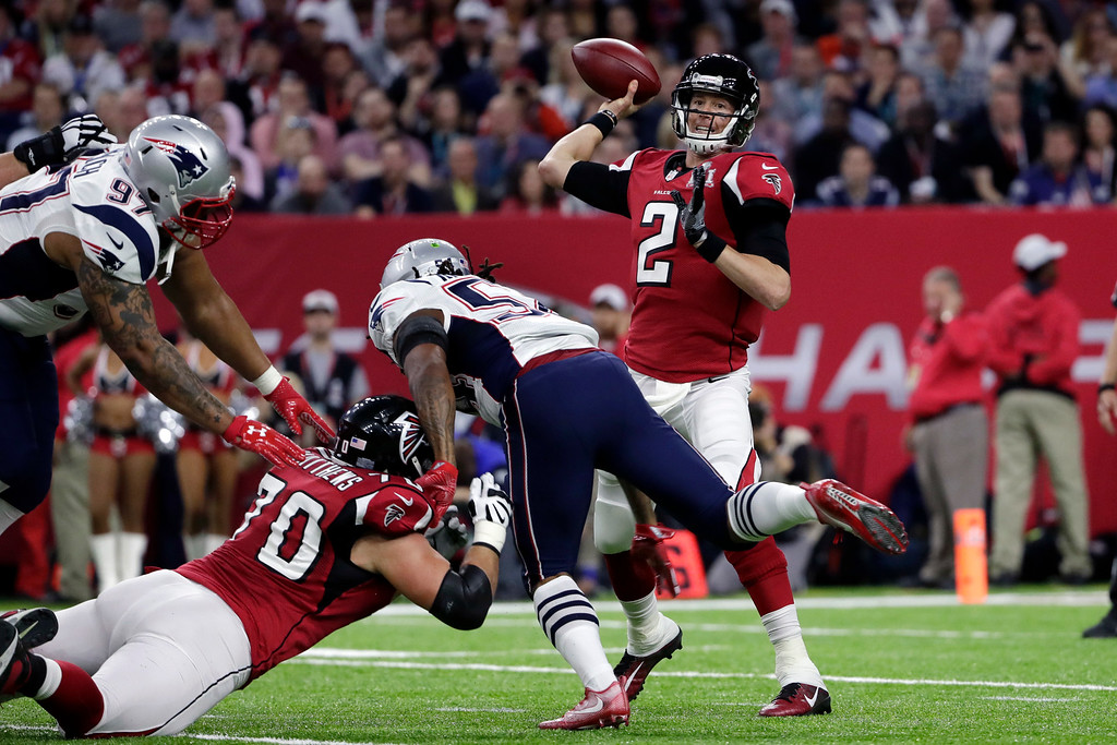. Atlanta Falcons\' Matt Ryan passes under pressure as Jake Matthews tries to block for him during the first half of the NFL Super Bowl 51 football game Sunday, Feb. 5, 2017, in Houston. (AP Photo/Matt Slocum)
