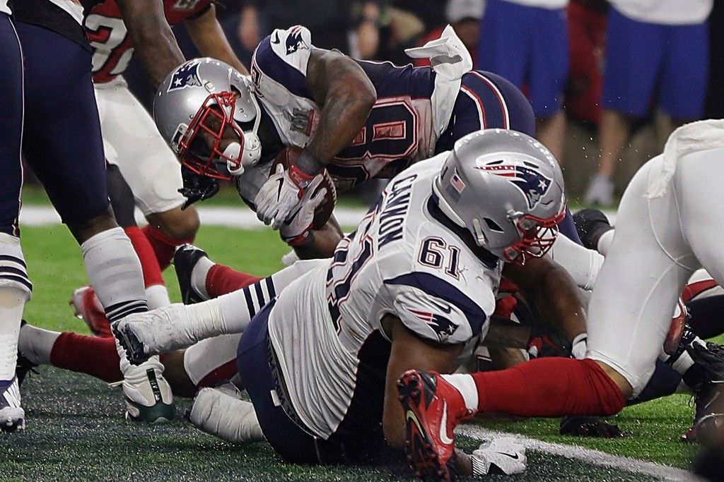 . New England Patriots\' James White, rear, scores a touchdown during the second half of the NFL Super Bowl 51 football game against the Atlanta Falcons, Sunday, Feb. 5, 2017, in Houston. (AP Photo/Matt Slocum)