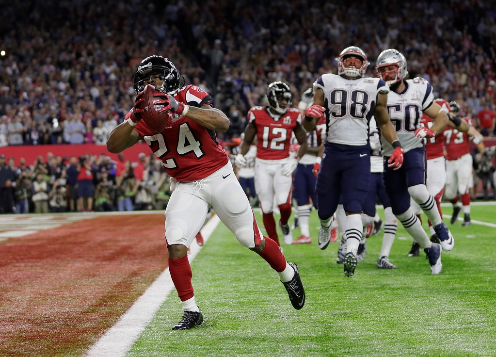 . Atlanta Falcons\' Devonta Freeman runs for a touchdown during the first half of the NFL Super Bowl 51 football game against the New England Patriots Sunday, Feb. 5, 2017, in Houston. (AP Photo/Mark Humphrey)
