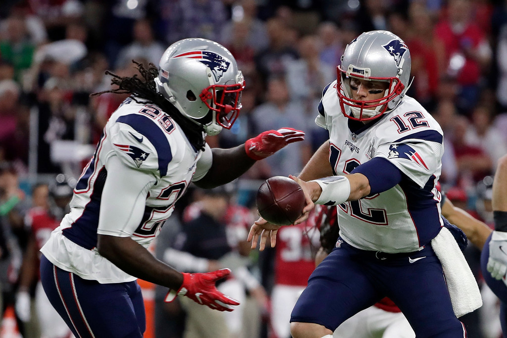 . New England Patriots\' Tom Brady naked off to LeGarrette Blount, left, during the first half of the NFL Super Bowl 51 football game against the Atlanta Falcons Sunday, Feb. 5, 2017, in Houston. (AP Photo/Matt Slocum)
