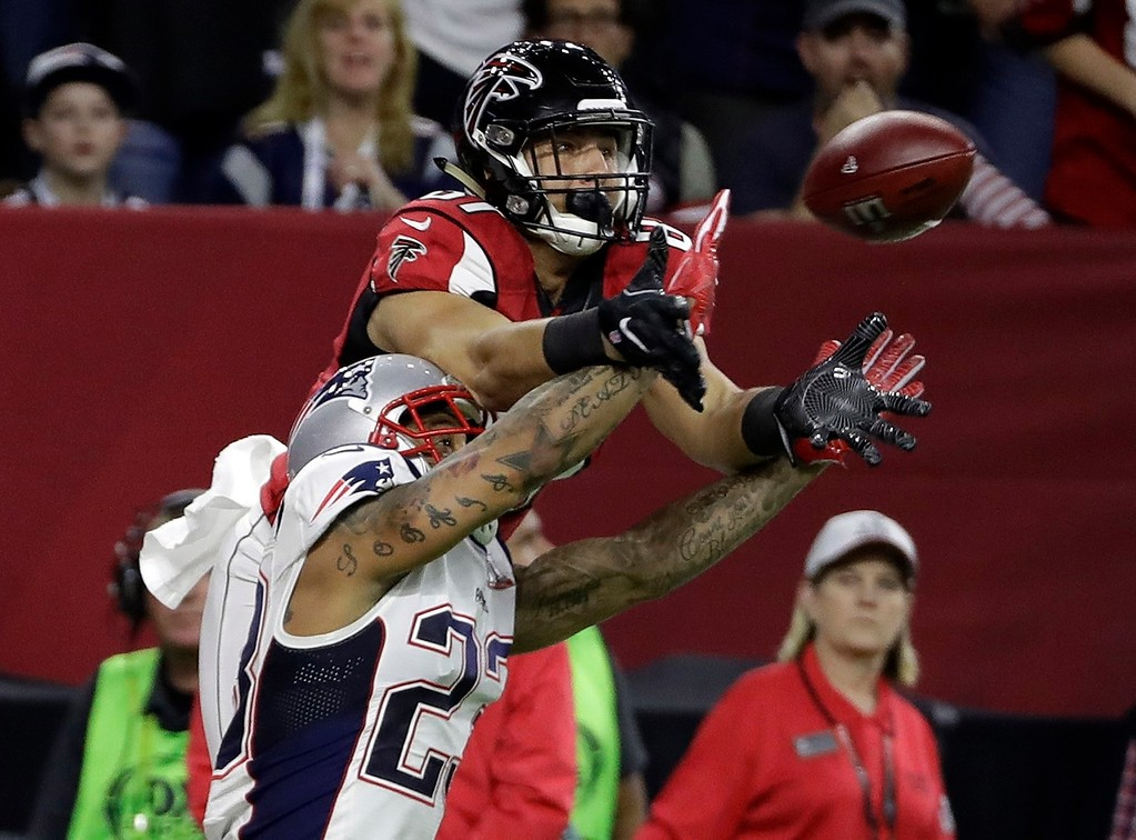 . New England Patriots\' Patrick Chung breaks up a pass intended for Atlanta Falcons\' Austin Hooper during the first half of the NFL Super Bowl 51 football game Sunday, Feb. 5, 2017, in Houston. (AP Photo/David J. Phillip)