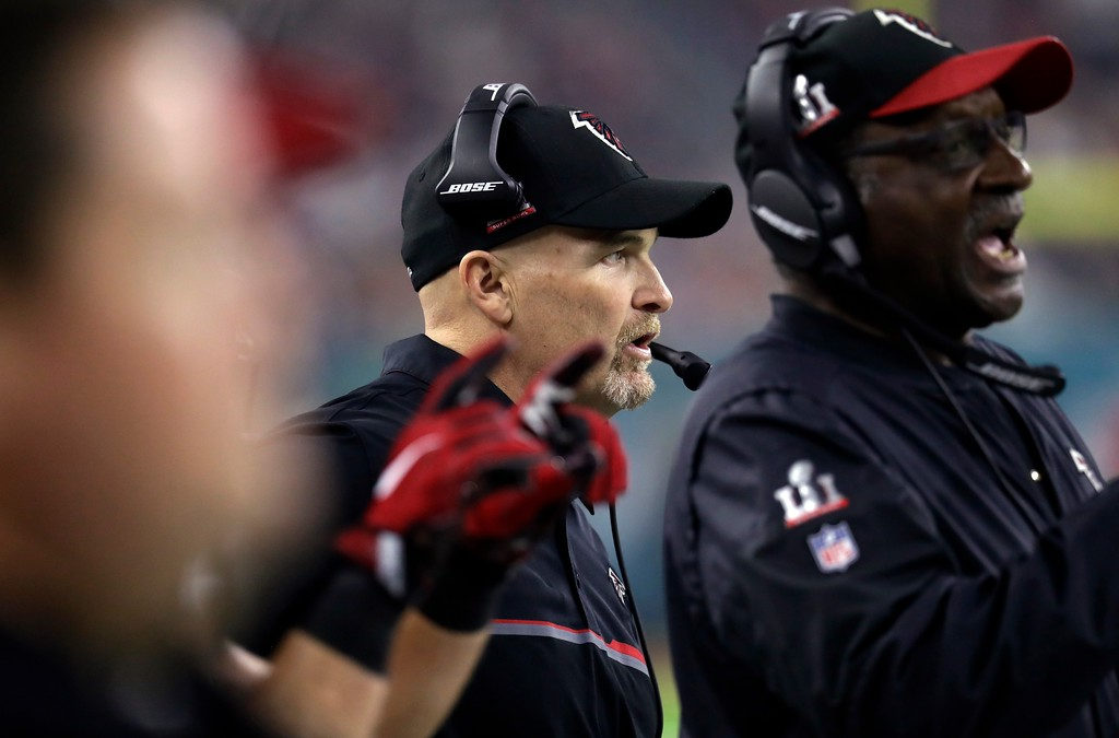 . Atlanta Falcons head coach Dan Quinn talks on his headset during the second half of the NFL Super Bowl 51 football game against the New England Patriots Sunday, Feb. 5, 2017, in Houston. (AP Photo/Eric Gay)
