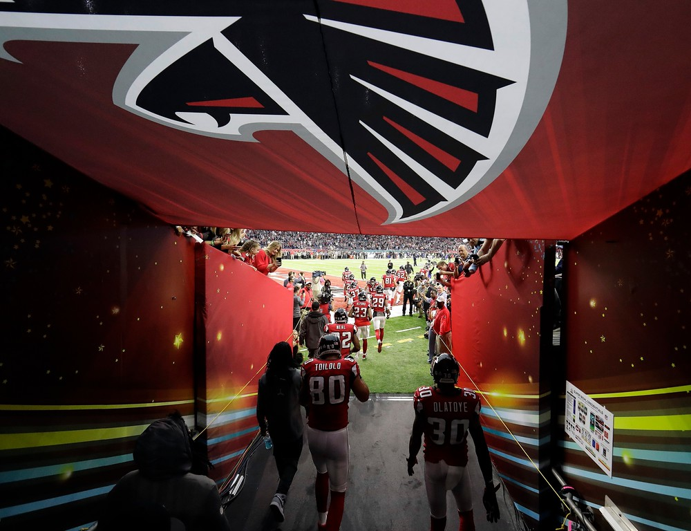 . Some Atlanta Falcons take the field before the NFL Super Bowl 51 football game against the New England Patriots Sunday, Feb. 5, 2017, in Houston. (AP Photo/Tony Gutierrez)