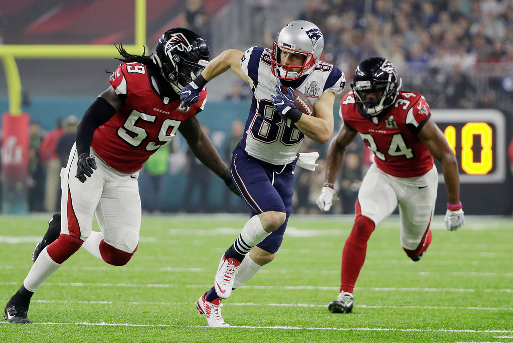 . New England Patriots\' Danny Amendola runs against Atlanta Falcons\' Brian Poole, right, and De\'Vondre Campbell, left, during the second half of the NFL Super Bowl 51 football game Sunday, Feb. 5, 2017, in Houston. (AP Photo/Mark Humphrey)