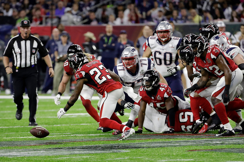 . Atlanta Falcons\' Robert Alford recovers a fumble during the first half of the NFL Super Bowl 51 football game against the New England Patriots Sunday, Feb. 5, 2017, in Houston. (AP Photo/David J. Phillip)