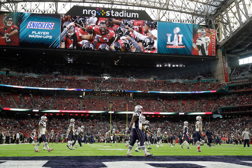 . New England Patriots players warm up before the NFL Super Bowl 51 football game against the Atlanta Falcons Sunday, Feb. 5, 2017, in Houston. (AP Photo/Chuck Burton)