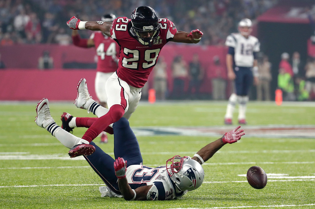 . Atlanta Falcons\' C.J. Goodwin breaks up a pass intended for New England Patriots\' Dion Lewis, below, during the second half of the NFL Super Bowl 51 football game Sunday, Feb. 5, 2017, in Houston. (AP Photo/Patrick Semansky)