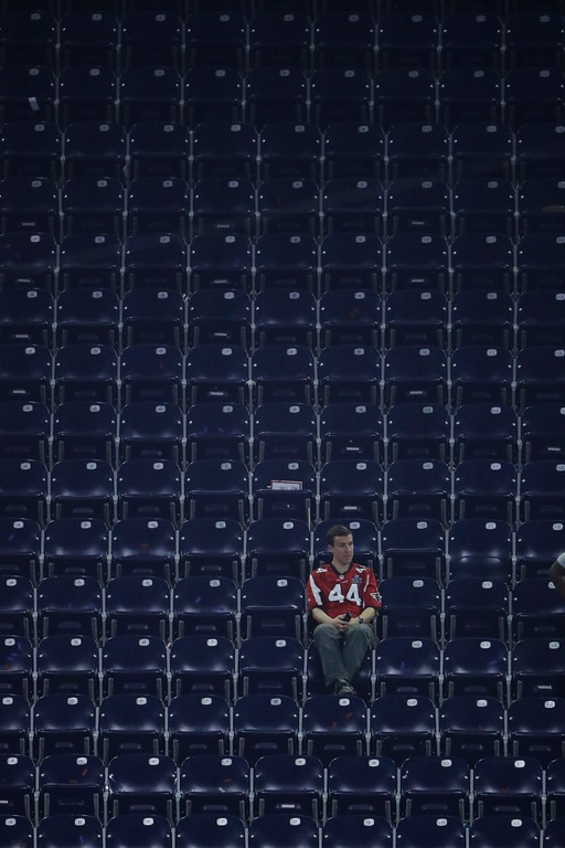 . An Atlanta Falcons fan sits in the stands after the NFL Super Bowl 51 football game against the New England Patriots, Sunday, Feb. 5, 2017, in Houston. (AP Photo/Charlie Riedel)