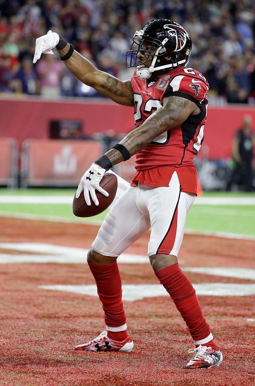 . Atlanta Falcons\' Robert Alford celebrates after scoring during the first half of the NFL Super Bowl 51 football game against the New England Patriots Sunday, Feb. 5, 2017, in Houston. (AP Photo/Tony Gutierrez)