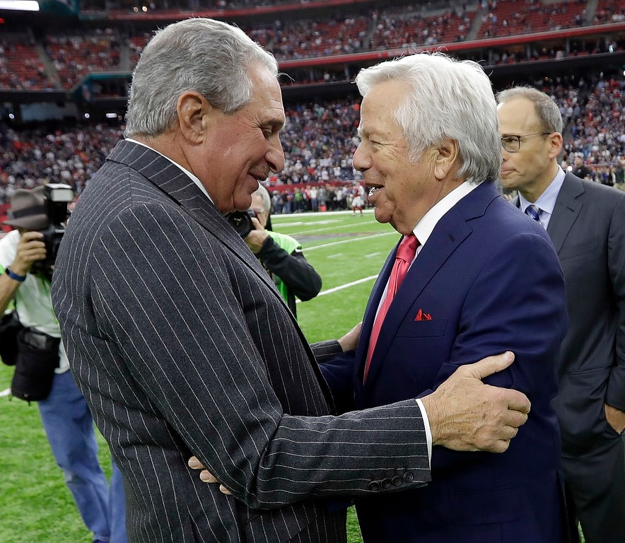 . New England Patriots owner Robert Kraft, right, greets Atlanta Falcons owner Arthur Blank before the NFL Super Bowl 51 football game Sunday, Feb. 5, 2017, in Houston. (AP Photo/David J. Phillip)