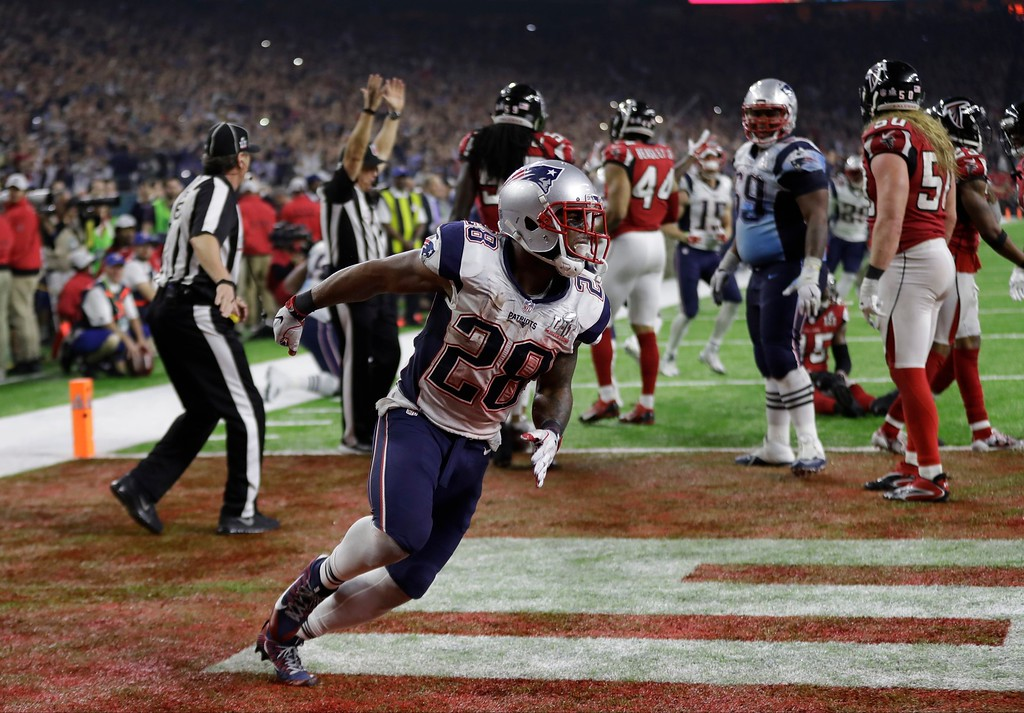. New England Patriots\' James White celebrates after scoring the winning touchdown during overtime of the NFL Super Bowl 51 football game against the Atlanta Falcons, Sunday, Feb. 5, 2017, in Houston. (AP Photo/Elise Amendola)