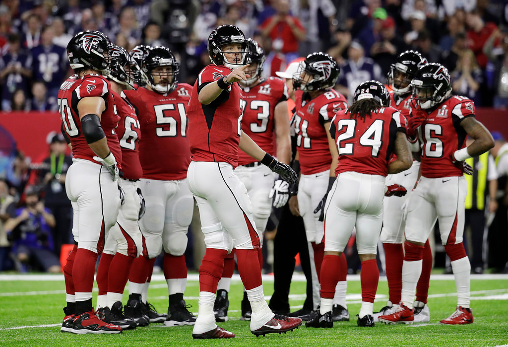 . Atlanta Falcons\' Matt Ryan, center, reacts on the field during the first half of the NFL Super Bowl 51 football game against the New England Patriots, Sunday, Feb. 5, 2017, in Houston. (AP Photo/Eric Gay)