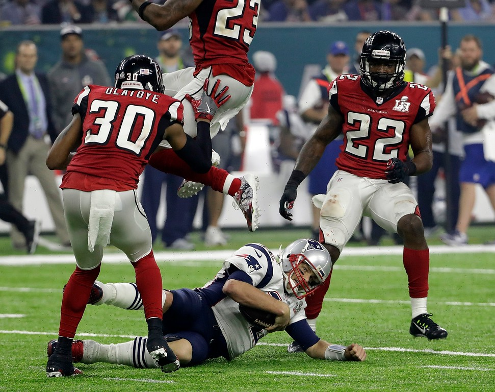 . New England Patriots\' Tom Brady slides against the Atlanta Falcons defense during the second half of the NFL Super Bowl 51 football game Sunday, Feb. 5, 2017, in Houston. (AP Photo/David J. Phillip)