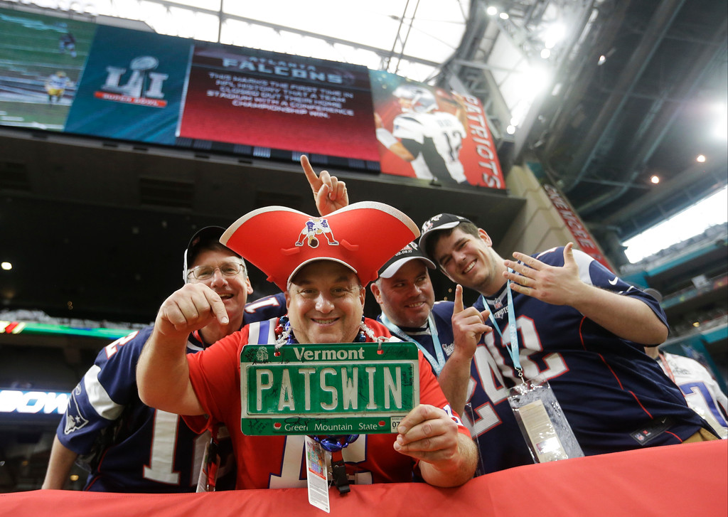 . New England Patriots fans pose during warms up before the NFL Super Bowl 51 football game between Patriots and the Atlanta Falcons, Sunday, Feb. 5, 2017, in Houston. (AP Photo/Elise Amendola)