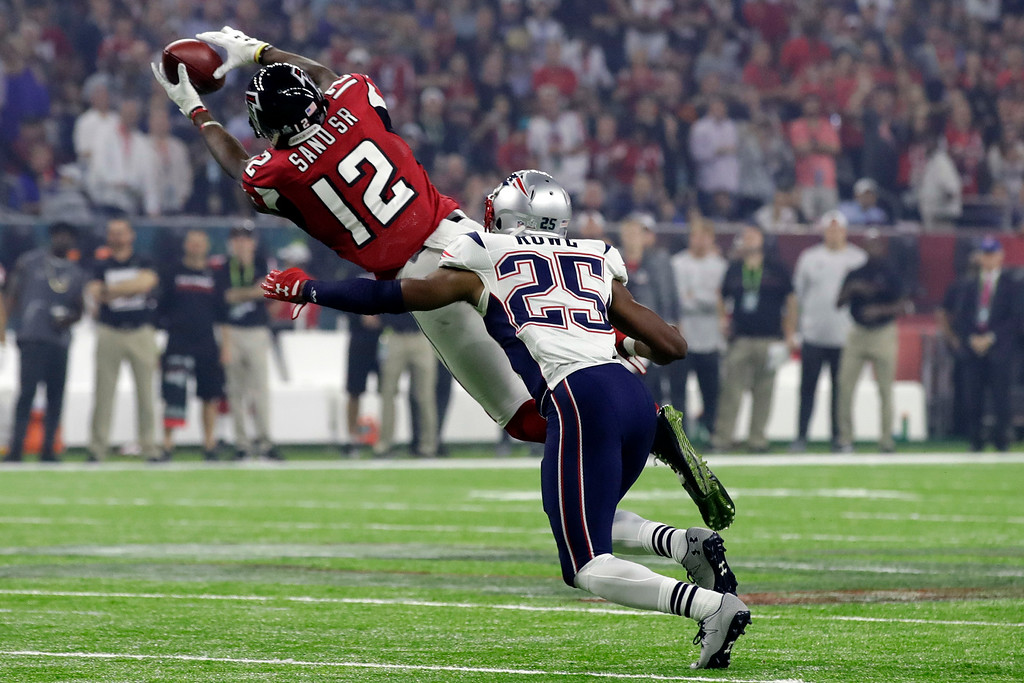 . Atlanta Falcons\' Mohamed Sanu pulls in a pass in front of New England Patriots\' Eric Rowe during the second half of the NFL Super Bowl 51 football game Sunday, Feb. 5, 2017, in Houston. (AP Photo/Patrick Semansky)