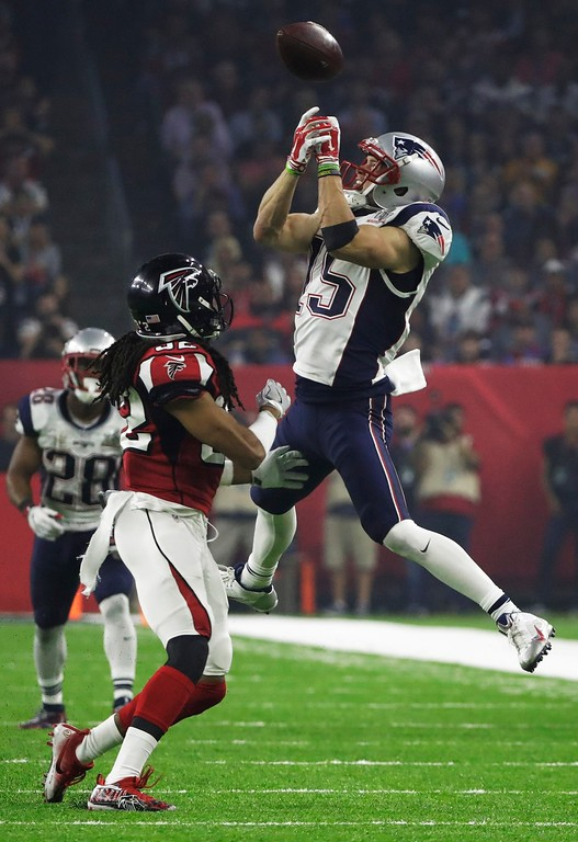 . Atlanta Falcons\' Jalen Collins breaks up a pass intended for New England Patriots\' Chris Hogan during the second half of the NFL Super Bowl 51 football game Sunday, Feb. 5, 2017, in Houston. (AP Photo/Tony Gutierrez)