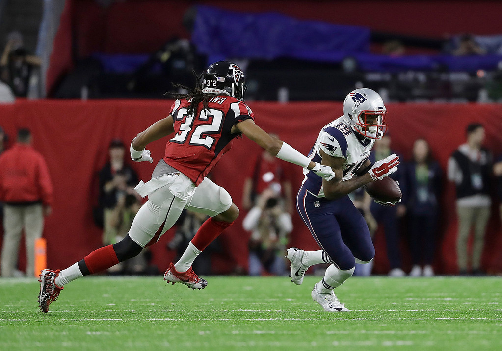 . New England Patriots\' Malcolm Mitchell (19) runs against Atlanta Falcons\' Jalen Collins during the first half of the NFL Super Bowl 51 football game Sunday, Feb. 5, 2017, in Houston. (AP Photo/Elise Amendola)