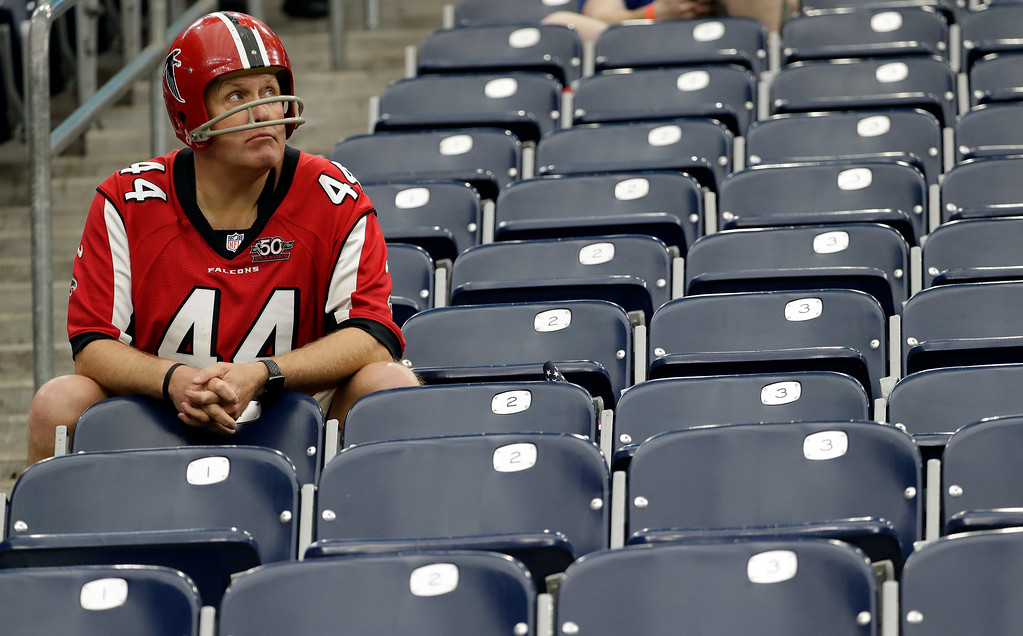 . An Atlanta Falcons fan sits in his seat before the NFL Super Bowl 51 football game against the New England Patriots Sunday, Feb. 5, 2017, in Houston. (AP Photo/David J. Phillip)