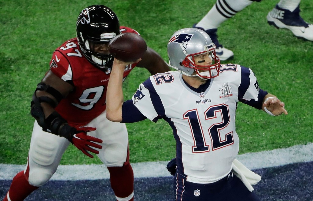. New England Patriots\' Tom Brady passes under pressure from Atlanta Falcons\' Grady Jarrett during the first half of the NFL Super Bowl 51 football game Sunday, Feb. 5, 2017, in Houston. (AP Photo/Charlie Riedel)