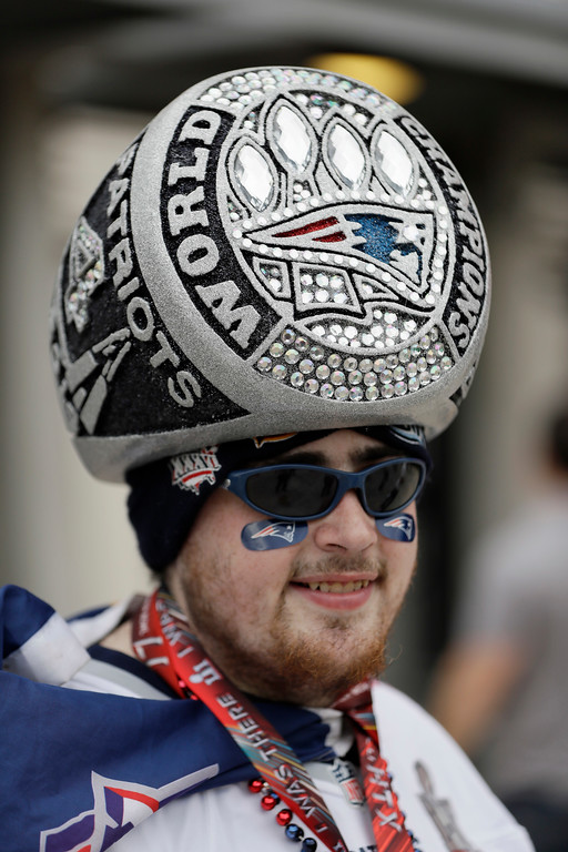. New England Patriots fan Sam Macasay wears a super ring hat before the NFL Super Bowl 51 football game against the Atlanta Falcons, Sunday, Feb. 5, 2017, in Houston. (AP Photo/Mark Humphrey)