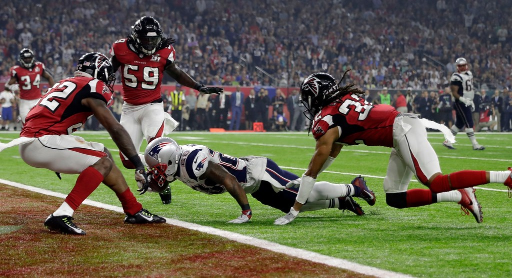. New England Patriots\' James White gets into the end zone for a touchdown during the second half of the NFL Super Bowl 51 football game against the Atlanta Falcons Sunday, Feb. 5, 2017, in Houston. (AP Photo/David J. Phillip)