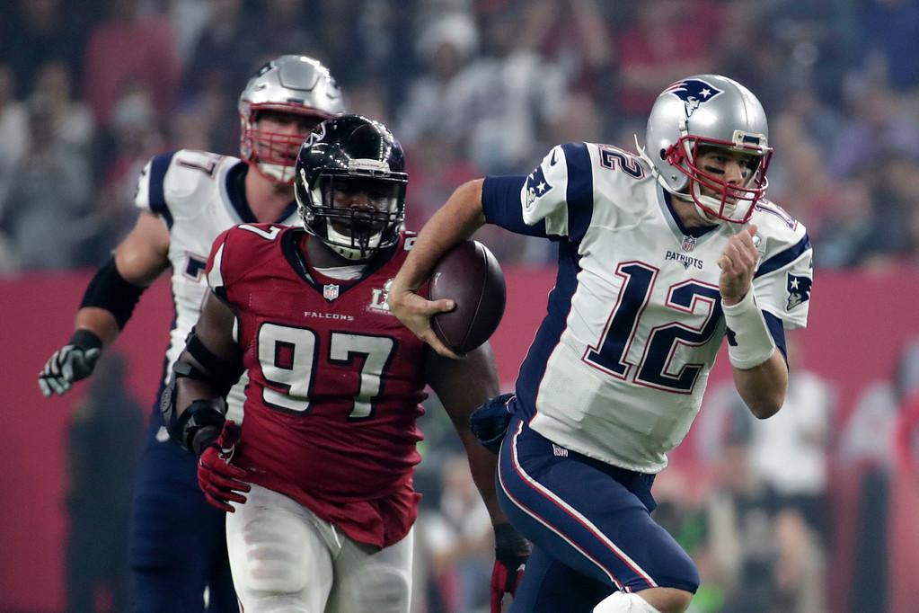. New England Patriots\' Tom Brady, right, carries past Atlanta Falcons\' Grady Jarrett during the second half of the NFL Super Bowl 51 football game Sunday, Feb. 5, 2017, in Houston. (AP Photo/Patrick Semansky)