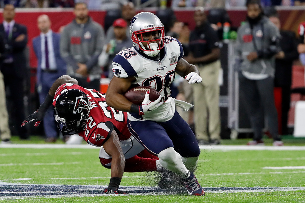 . New England Patriots\' James White eludes Atlanta Falcons\' Keanu Neal, behind, during the first half of the NFL Super Bowl 51 football game Sunday, Feb. 5, 2017, in Houston. (AP Photo/Matt Slocum)