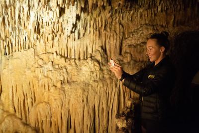 Athletes visit a Cave