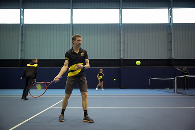 Athletes play Tennis