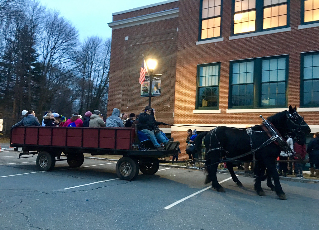. Families bundled up for hay rides around Billerica Town Hall at the New Year\'s eve celebration. Photo by Mary Leach