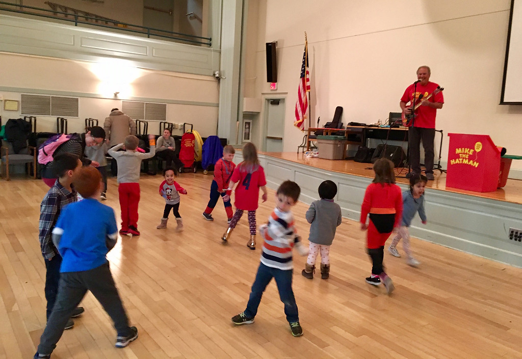 . Children danced to the music of the Hat Man in Billerica Town Hall. Photo by Mary Leach