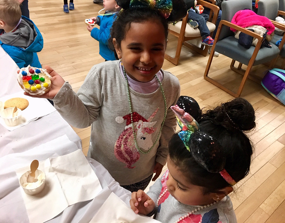 . Anissa and Norah Bitahi of Billerica were all smiles as they decorated cookies. Photo by Mary Leach
