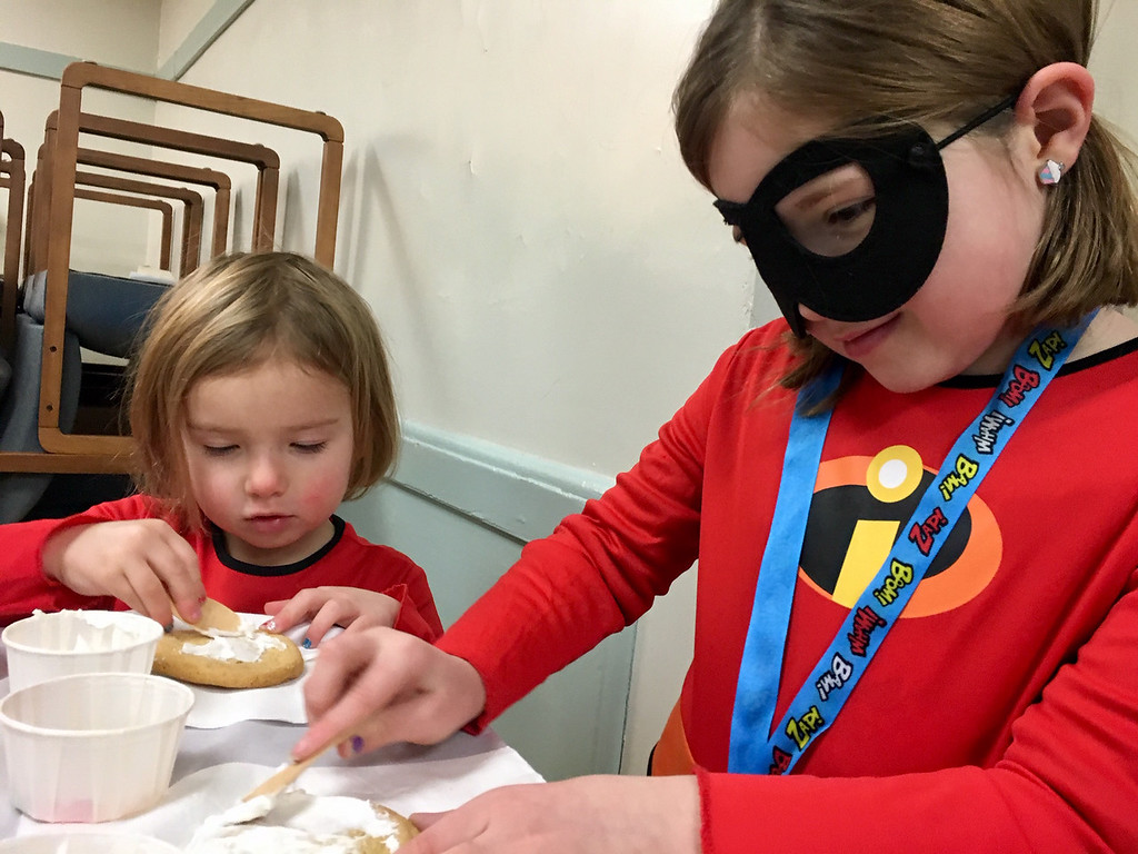 . Rori Naughton, 6, (right), of Billerica, decorated cookies with her sister, Kenna Naughton, 3. Photo by Mary Leach