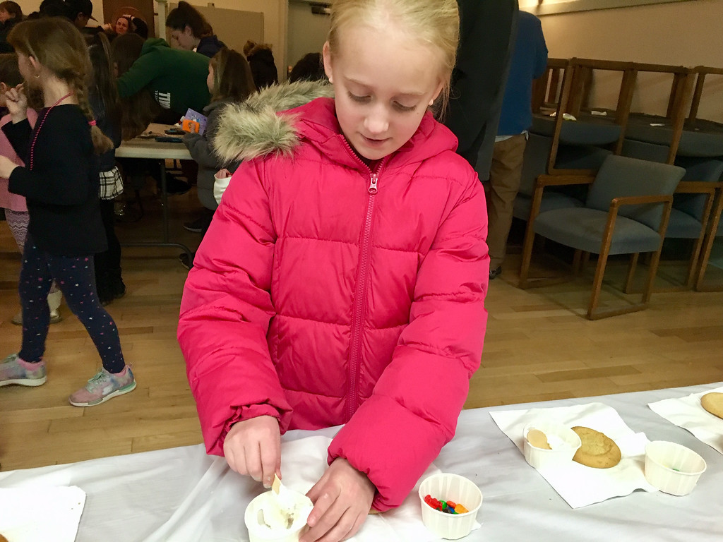 . Emily Turner, 9, of Chelmsford, decorated a holiday cookie. Photo by Mary Leach
