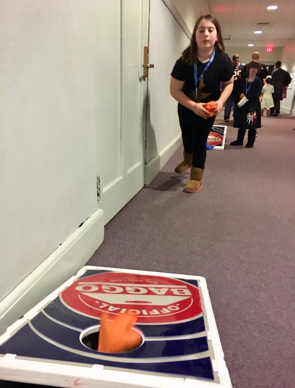. Dylan Jolly, 9, of Groton, played a cornhole game. Photo by Mary Leach