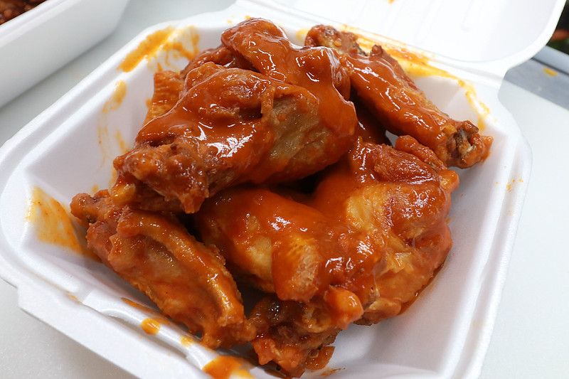 After years of operating in a small building Super Wings has moved into a a new space. With a much larger kitchen and dining room, they're celebrating a big step forward. This is their buffalo wings that they sell. SENTINEL & ENTERPRISE/JOHN LOVE