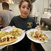 After years of operating in a small building Super Wings has moved into a a new space. With a much larger kitchen and dining room, they're celebrating a big step forward. Owner Maria Garcia shows off some of their tacos tex mex that they serve at the restaurant. SENTINEL & ENTERPRISE/JOHN LOVE