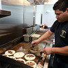 After years of operating in a small building Super Wings has moved into a a new space. With a much larger kitchen and dining room, they're celebrating a big step forward. Owner Luis Garcia cooks up some tacos in their new kitchen on Friday. SENTINEL & ENTERPRISE/JOHN LOVE