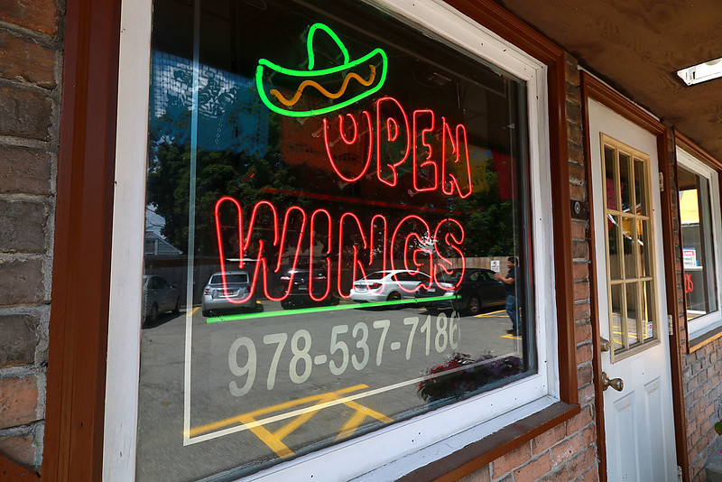 After years of operating in a small building Super Wings has moved into a a new space. With a much larger kitchen and dining room, they're celebrating a big step forward. SENTINEL & ENTERPRISE/JOHN LOVE