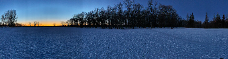 A 270 degree panorama with the sun setting on the left and the moon rising on the right