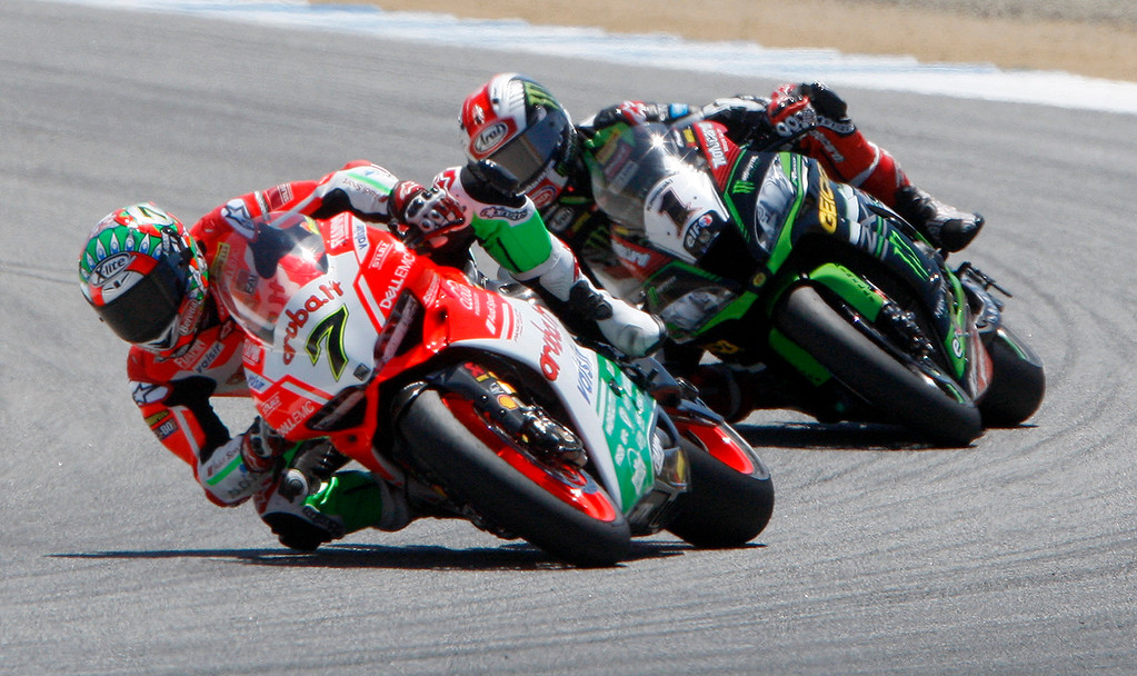 . Chaz Davies (7) from Great Britain leads Jonathan Rea (1) into turn-3 at the FIM Superbike World Championship at Mazda Raceway Laguna Seca on Saturday, July 8, 2017.  (Vern Fisher - Monterey Herald)